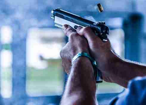 Person shooting gun at a range
