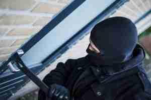 Man comitting burglary