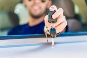 Man holding car keys