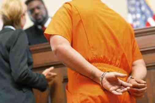 Defendant in orange suit
