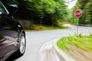 Car speeding down the highway