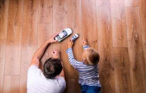 father playing cars with his child