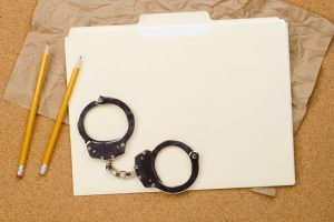 file folder with handcuffs