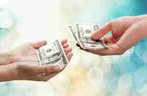 Handing woman money