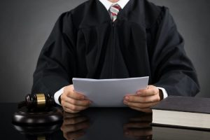 Judge reading document
