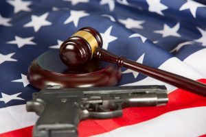 gun, flag, and gavel