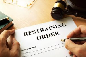 Judge signing restraining order