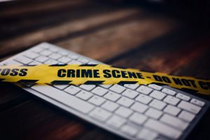 keyboard with crime scene tape