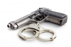 Gun with silver handcuffs