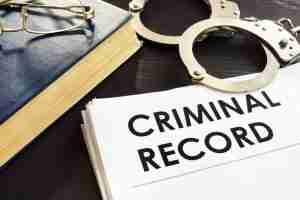 Criminal record and handcuffs