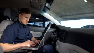 Officer looking at computer