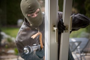 burglar opening door