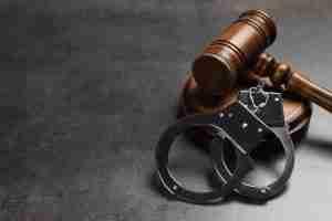 judge gavel next to handcuffs