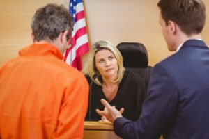 Defendant and Lawyer in front of judge